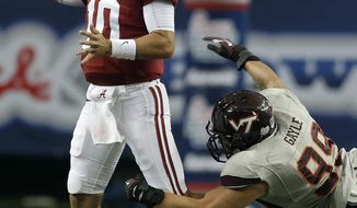 Alabama quarterback AJ McCarron (10) is pursued by Virginia Tech defensive end James Gayle (99) as he looks for a receiver in the first half of an NCAA college football game, Saturday, Aug. 31, 201, in Atlanta. (AP Photo/Dave Martin)