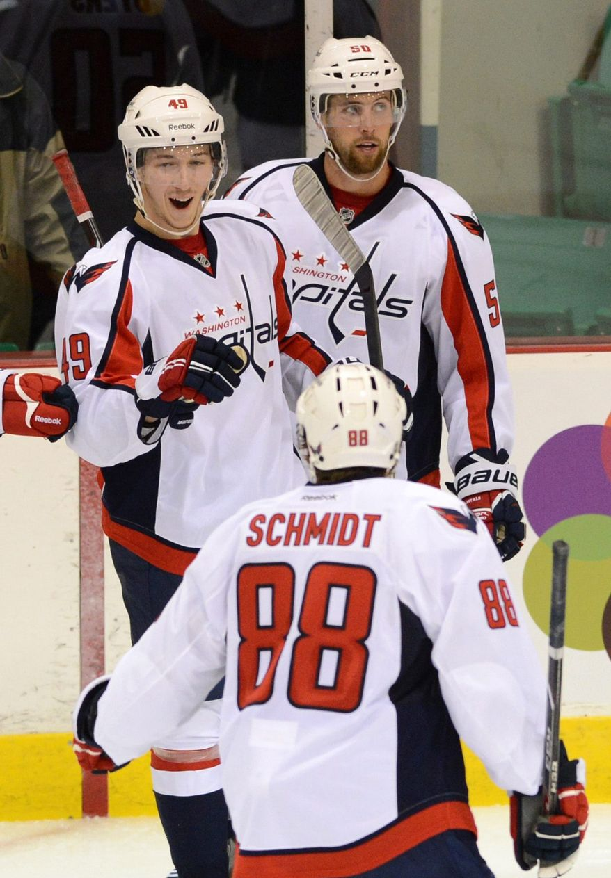 Washington Capitals' Stanislav Galiev, top left, celebrates a goal with teammates against the Winnipeg Jets during preseason NHL hockey game in Belleville, Ontario, on Saturday, Sept. 14, 2013. (AP Photo/The Canadian Press, Sean Kilpatrick)