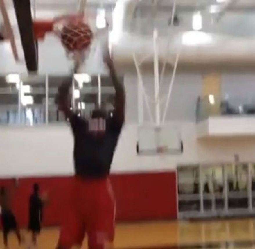 Kevin Ware is shown dunking a basketball in footage uploaded to YouTube by a teammate Sept. 16, 2013. (Image: YouTube)