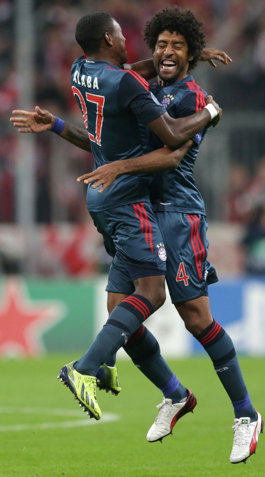 Bayern's David Alaba of Austria, left, and teammate Dante of Brazil celebrate after scoring their side's opening goal during the Champions League first round group D soccer match between FC Bayern Munich and CSKA Moscow, in Munich, Germany, Tuesday, Sept. 17, 2013. (AP Photo/Matthias Schrader)