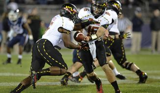 Maryland quarterback C.J. Brown (16) hands off to running back Albert Reid (5) during the second half of an NCAA college football game against Connecticut at Rentschler Field, Saturday, Sept. 14, 2013 in East Hartford, Conn. Maryland won 32-21. (AP Photo/Jessica Hill)