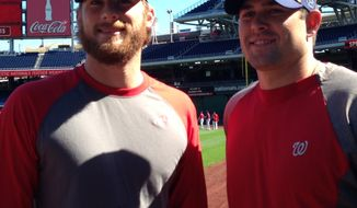 Nationals pitchers Ross Detwiler and Craig Stammen don Navy caps ahead of game with Atlanta Braves. (Amanda Comak/Washington Times)