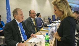 Michael Kirby (left), chairman of the Commission of Inquiry on Human Rights in North Korea, speaks with Ambassador Eileen Chamberlain Donahoe, U.S. representative to the Human Rights Council, before he delivers his report to the 24th session of the council at the European headquarters of the United Nations in Geneva on Tuesday, Sept. 17, 2013. (AP Photo/Keystone, Salvatore Di Nolfi)