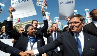 Employees and officials of US Airways and American Airlines gathered outside the U.S. Capitol on Wednesday afternoon to show their support for the companies' planned $11 billion merger and press the Justice Department to drop its opposition. (PRNEWSFOTO)