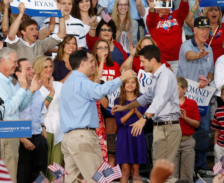 Rep. Paul Ryan (right) and Wisconsin Gov. Scott Walker are Republicans from the same state who have been mentioned as 2016 presidential candidates. Mr. Walker has said he would not compete against his fellow Wisconsinite in a primary. (associated press)