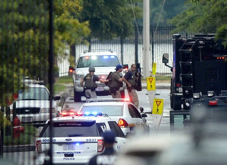 D.C police on the Navy Yard Monday. Associated Press photo