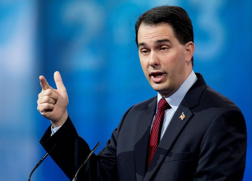 Divisive: Wisconsin Gov. Scott Walker delivered a well-received speech at the Conservative Political Action Conference this year, but he made some enemies among advocates of collective bargaining rights for state workers. (Associated Press photographs)