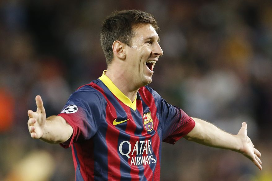 Barcelona's Lionel Messi celebrates scoring 1-0 during the Champions League group H soccer match between Ajax Amsterdam and F.C. Barcelona on Wednesday, Sept. 18, 2013, at Camp Nou stadium in Barcelona, Spain. (AP Photo/Emilio Morenatti)