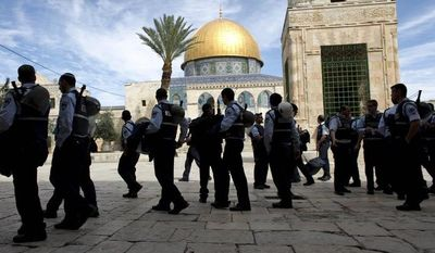 ** FILE ** Israeli police walk through the Al-Aqsa mosque compound, also known to Jews as the Temple Mount, in Jerusalem's Old City on Wednesday, March 17, 2010. (AP Photo/Tara Todras-Whitehill)