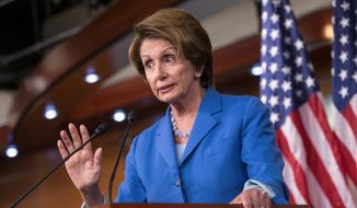"House Minority Leader Nancy Pelosi, California Democrat, said Republicans are ""playing with fire"" with a bill that would prevent a partial government shutdown and avoid a historic national default while canceling out President Obama's health care overhaul. (Associated Press)"
