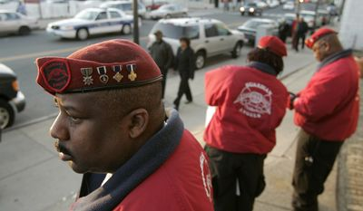 7 — Guardian Angels commander for Washington D.C., John Ayala, left, stands on Washington Street in Boston's Dorchester neighborhood on March 29, 2007, moments before the start of a community meeting between local citizens and the Guardian Angels at the Global Ministries Christian Church. (Associated Press)