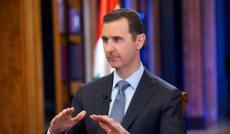 "In this photo released on early Thursday Sept. 19, 2013, by the Syrian official news agency SANA, Syrian President Bashar Assad speaks during an interview with Fox News channel, in Damascus, Syria. Assad says a United Nations report finding ""clear and convincing evidence"" that sarin nerve gas was used in Syria painted an ""unrealistic"" account, and he denied his government orchestrated the attack. (AP Photo/SANA)"
