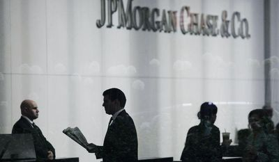 ** FILE ** People arrive at JPMorgan Chase headquarters in New York on May 14, 2012. (Associated Press)
