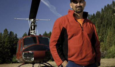 """William Bart Colantuono, a helicopter pilot who previously appeared in the History channel's """"Ax Men"""" series, died on Tuesday, Sept. 17, 2013, when his chopper crashed while attempting to lift logs in an Oregon forest. (AP Photo/History)"""