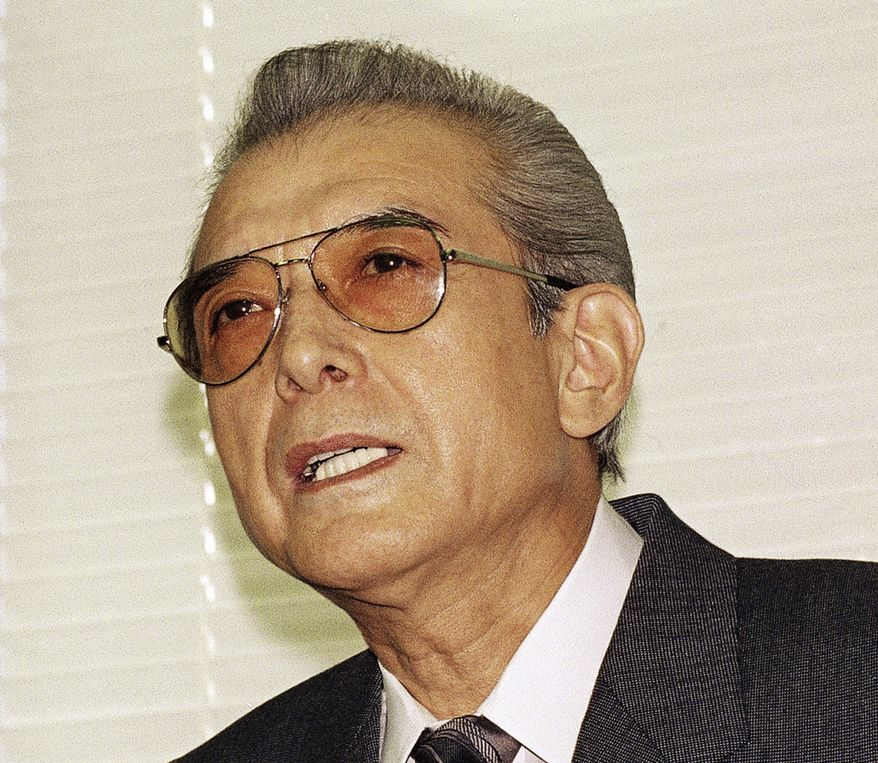 Hiroshi Yamauchi, shown in 1992 when he was president of Japan's Nintendo Co., answers questions during a news conference at company headquarters in Kyoto, Japan, after he won final approval to buy the Seattle Mariners. (AP Photo/Katsumi Kasahara)
