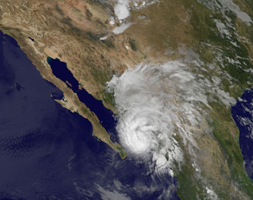 This image provided by NOAA shows Hurricane Manuel taken at 3:45 a.m. EDT Thursday, Sept. 19, 2013. The U.S. National Hurricane Center said Manuel was a Category 1 hurricane hugging Mexico's coast early Thursday and expected to produce 75 mph winds and between 5 and 10 inches of rain over the state of Sinaloa. (AP Photo/NOAA)