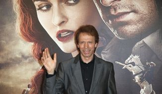 """**FILE** Producer Jerry Bruckheimer poses for photographers as he arrives at the cinema for the French premiere of """"The Lone Ranger"""" in Paris on July 24, 2013. (Associated Press)"""