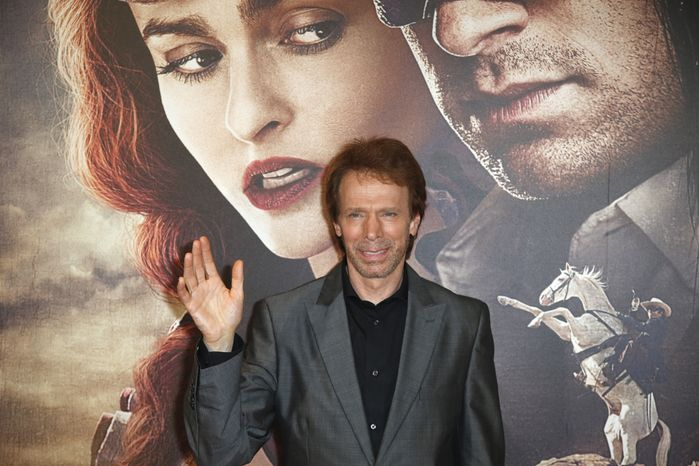 "**FILE** Producer Jerry Bruckheimer poses for photographers as he arrives at the cinema for the French premiere of ""The Lone Ranger"" in Paris on July 24, 2013. (Associated Press)"