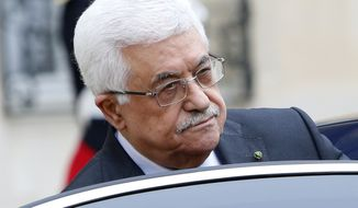 **FILE** Palestinian leader Mahmoud Abbas enters his car after a meeting with French President Francois Hollande at the Elysee Palace in Paris on Sept. 12, 2013. (Associated Press)