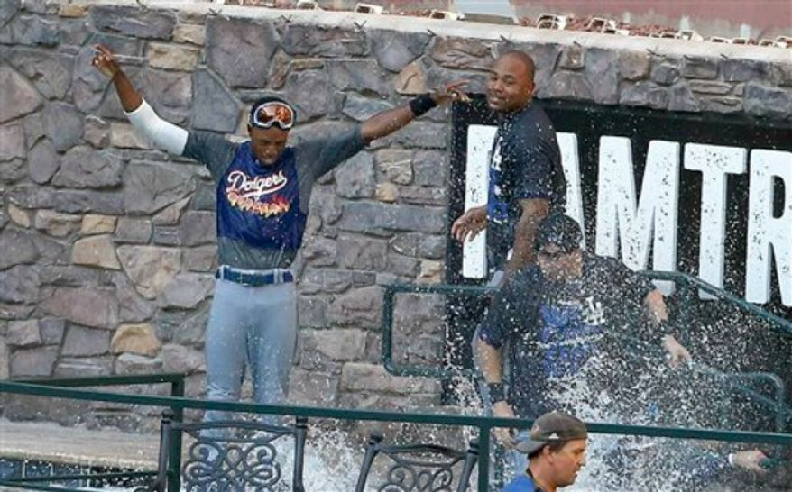 Los Angeles Dodgers players celebrate in the Chase Field pool after the Dodgers clinched the NL West title with a 7-6 win over the Arizona Diamondbacks in a baseball game Thursday, Sept. 19, 2013, in Phoenix. (AP Photo/Ross D. Franklin)