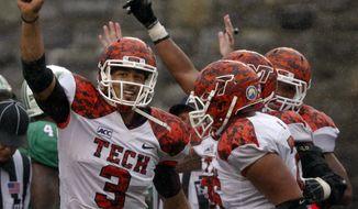Virginia Tech quarterback Logan Thomas (3) celebrates scoring the winning touchdown after a third overtime during an NCAA college football game against Marshall on Saturday, Sept. 21, 2013 in Blacksburg, Va. Virginia Tech won 20-21. (AP Photo/The Roanoke Times, Matt Gentry)