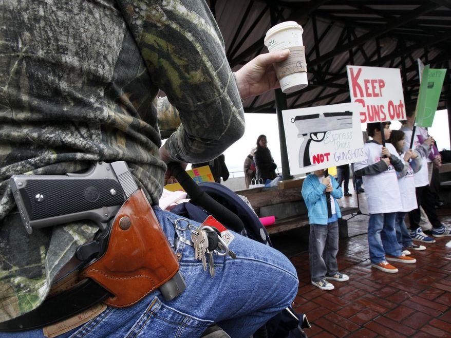 ** FILE ** A Seattle Starbucks, 2010. (Associated Press)