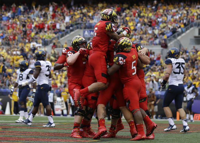 Maryland celebrates a touchdown by tight end Dave Stinebaugh in the first half of an NCAA college football game against West Virginia in Baltimore, Saturday, Sept. 21, 2013. (AP Photo/Patrick Semansky)