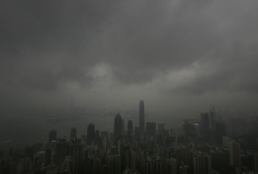 Dark clouds associated with Typhoon Usagi hang low over Hong Kong's Victoria Harbor on Sunday, Sept. 22, 2013. (AP Photo/Vincent Yu)