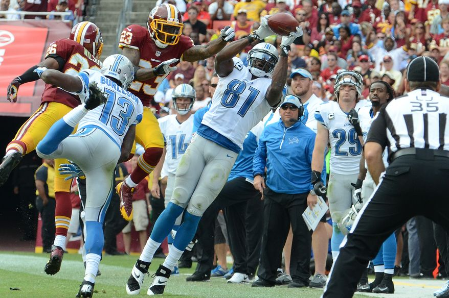 Detroit Lions wide receiver Calvin Johnson (81) hauls in a first down reception during the fourth quarter as the Washington Redskins play the Detroit Lions at FedExField, Landover, Md., September 22, 2013. (Dan DeCook/Special for The Washington Times)