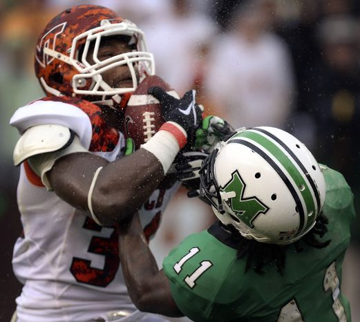 Virginia Tech's Kyshoen Jarrett, left, intercepts a pass in the end zone intended for Marshall's Devon Smith (11) during an NCAA college football game Saturday, Sept. 21, 2013 in Blacksburg, Va. Virginia Tech won 20-21. (AP Photo/The Roanoke Times, Matt Gentry)