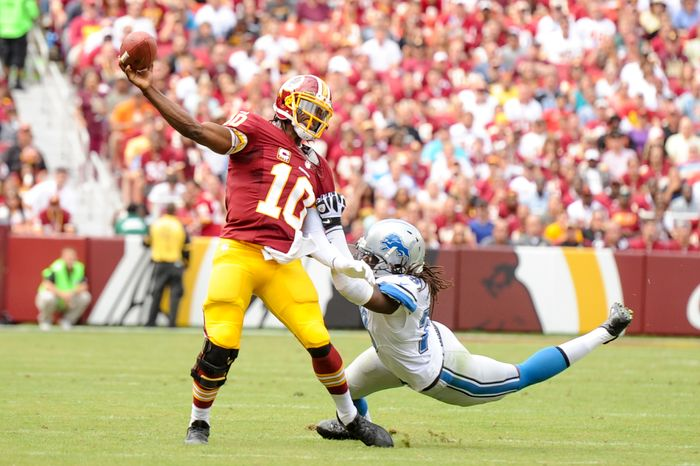 Washington Redskins quarterback Robert Griffin III (10) throws an interception on the run in the second quarter as the Washington Redskins play the Detroit Lions in NFL football at FedExField, Landover, Md., Monday, September 9, 2013. (Andrew Harnik/The Washington Times)