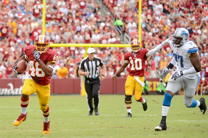 Washington Redskins running back Alfred Morris (46) scores on a 30 yard run in the second quarter as the Washington Redskins play the Detroit Lions in NFL football at FedExField, Landover, Md., Monday, September 9, 2013. (Andrew Harnik/The Washington Times)