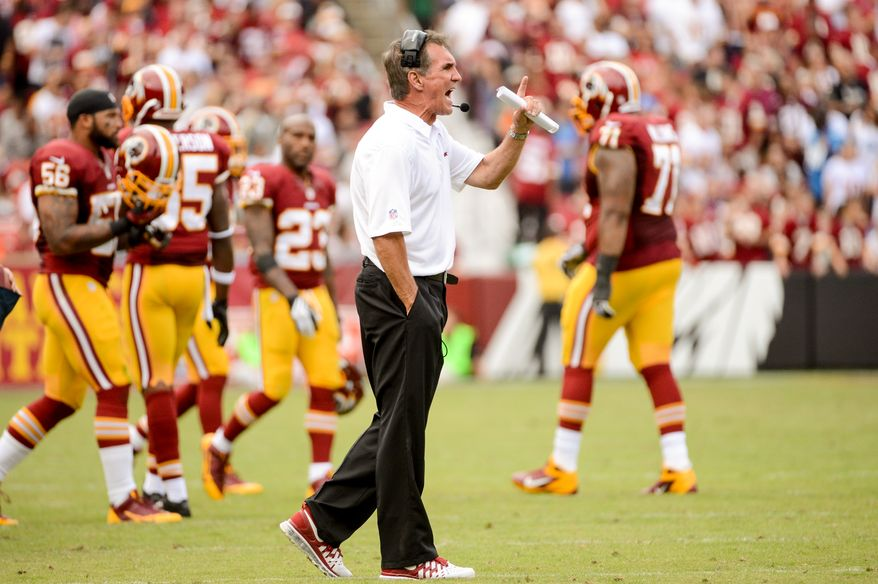 Washington Redskins head coach Mike Shanahan yells as referees after they rule that Washington Redskins quarterback Robert Griffin III (10) fumbled on a keeper run in the forth quarter as the  Washington Redskins play the Detroit Lions in NFL football at FedExField, Landover, Md., Monday, September 9, 2013. (Andrew Harnik/The Washington Times)