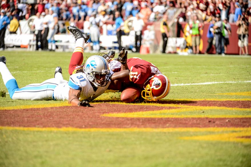 Washington Redskins wide receiver Aldrick Robinson (11) catches a 57 yard touchdown pass over Detroit Lions defensive back Rashean Mathis (31) in the fourth quarter that was reversed and ruled incomplete as the Washington Redskins play the Detroit Lions in NFL football at FedExField, Landover, Md., Monday, September 9, 2013. (Andrew Harnik/The Washington Times)
