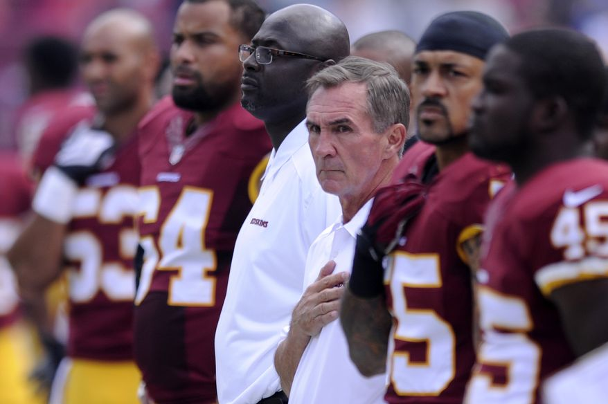Washington Redskins head coach Mike Shanahan joins his team on the sidelines for the National Anthem before the Washington Redskins play the Detroit Lions at FedExField, Landover, Md., September 22, 2013. (Preston Keres/Special for The Washington Times)