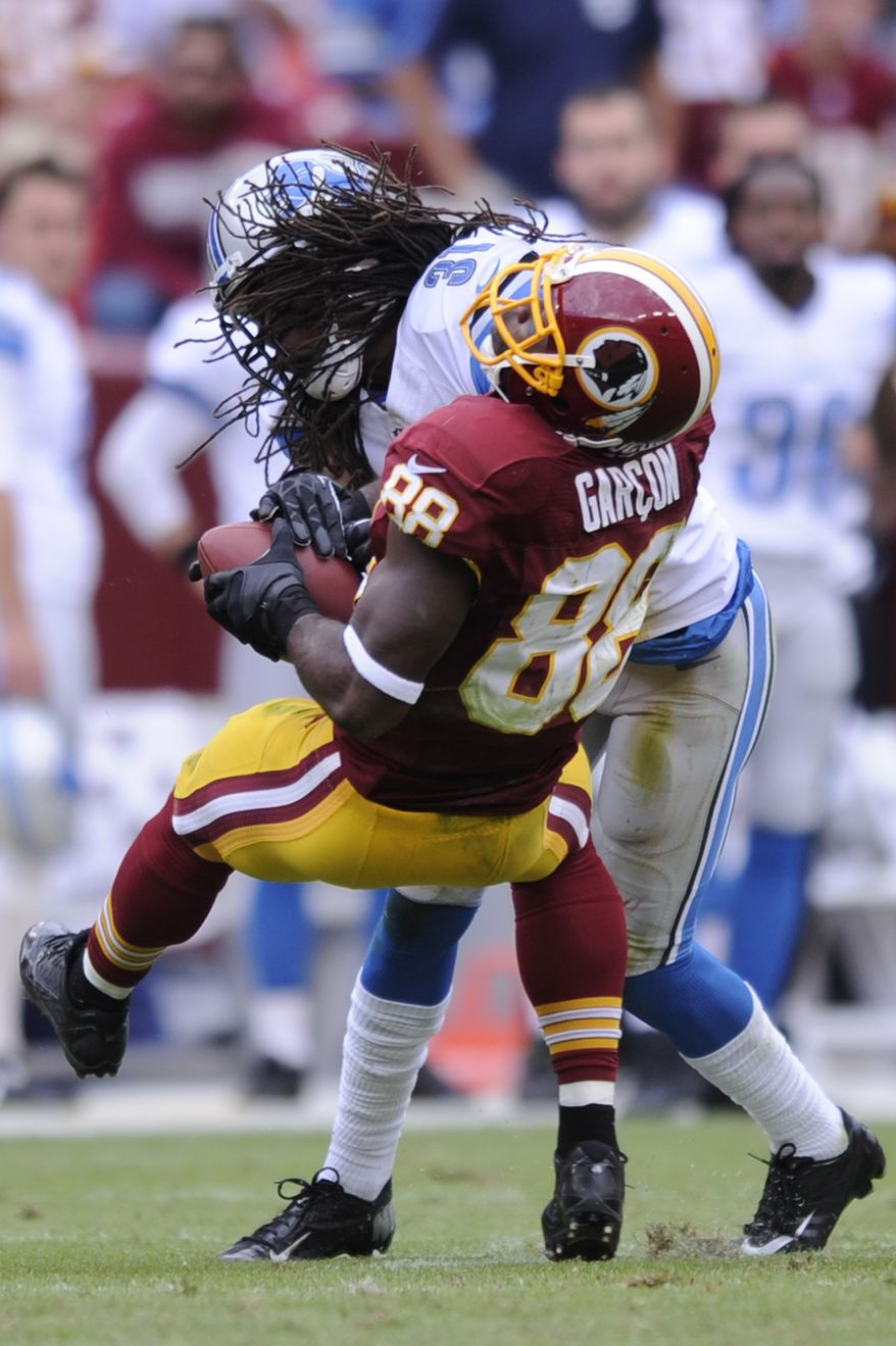 Detroit Lions defensive back Rashean Mathis (31) hits Washington Redskins wide receiver Pierre Garcon (88) but is called for unnecessary roughness in the fourth quarter as the Washington Redskins play the Detroit Lions at FedExField, Landover, Md., September 22, 2013. (Preston Keres/Special for The Washington Times)