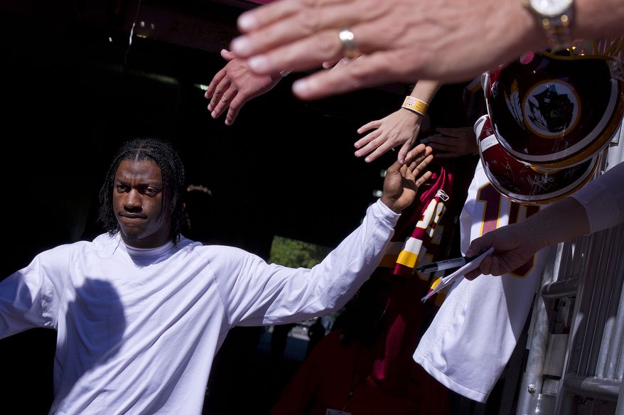 Washington Redskins quarterback Robert Griffin III  heads to the field for pregame warmups before his Washington Redskins play the Detroit Lions at FedExField, Landover, Md., September 22, 2013. (Preston Keres/Special for The Washington Times)