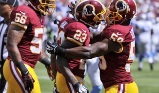 Washington Redskins cornerback DeAngelo Hall (23) is congratulated by inside linebacker London Fletcher (59) after scoring a touchdown on his first quarter interception as the Washington Redskins play the Detroit Lions at FedExField, Landover, Md., September 22, 2013. (Preston Keres/Special for The Washington Times)