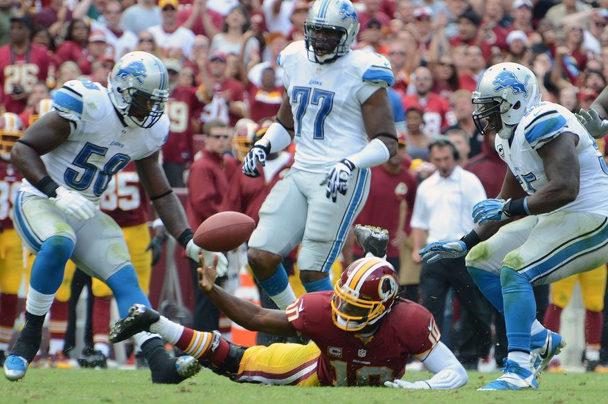Washington Redskins quarterback Robert Griffin III (10)fumbles during the fourth quarter as the Washington Redskins play the Detroit Lions at FedExField, Landover, Md., September 22, 2013. (Dan DeCook/Special for The Washington Times)