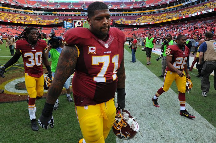 A dejected Washington Redskins tackle Trent Williams (71) walks off the field with teamates after a 27-20 to the Detroit Lions at FedExField, Landover, Md., September 22, 2013. (Preston Keres/Special for The Washington Times)