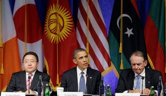 President Obama, flanked by Mongolia's President Tsakhiagiin Elbegdorj (left) and Deputy Secretary-General of the United Nations Jan Eliasson, attends a roundtable event Monday in New York. (ASSOCIATED PRESS)