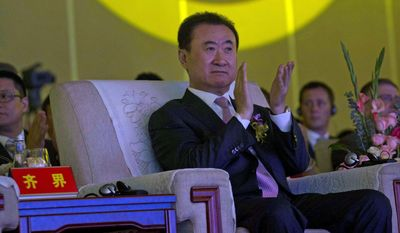 Pictured is Chinese tycoon Wang Jianlin, who plans to spend $8 billion building a Chinese version of Hollywood. (AP Photo/Ng Han Guan, File)