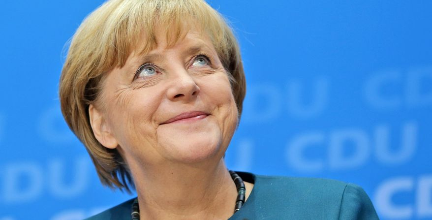Angela Merkel, German chancellor and chairwoman of the Christian Democratic party, smiles during a news conference after a party's board meeting in Berlin on Sept. 23, 2013. (Associated Press)