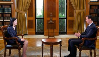 Syrian President Bashar Assad (right) gives an interview to Chinese state television channel CCTV in Damascus, Syria, on Monday, Sept. 23, 2013. Mr. Assad said his government will allow international experts access to its chemical weapons sites, but he cautioned that rebels might block them from reaching some of the locations. (AP Photo/SANA)