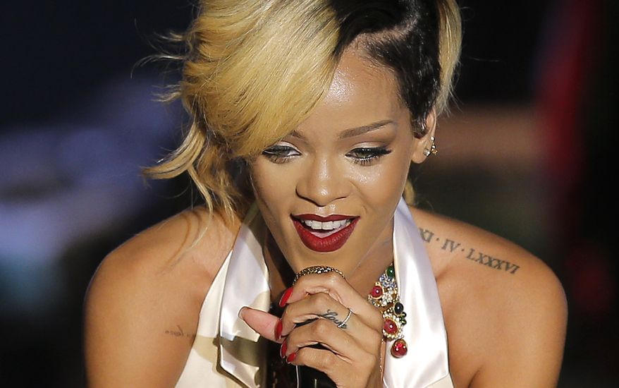 Rihanna (shown performing in Monaco in July during her Diamonds World Tour) has left behind a trail of racy tweets and an incriminating Instagram photograph from a Thailand trip that led police to arrest two men for peddling protected primates. (AP Photo/Lionel Cironneau, File)