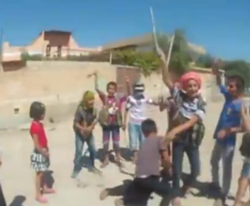 """A screen capture of a video posted to YouTube that appears to show a group of Syrian children playing a game called """"Behead the Enemy"""" while chanting """"Allahu Akbar,"""" or """"Allah is greater,"""" is seen here."""