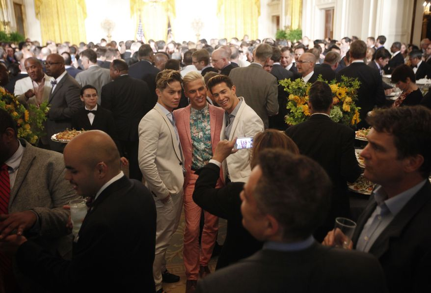 **FILE** Invited guests are seen posing for photographs in the East Room of the White House during a reception to celebrate lesbian, gay, bisexual, and transgender (LGBT) Pride month in Washington on June 13, 2013. The Obama administration has held a Pride reception at the White House for each of the previous four years President Obama has been in office. Attendees are typically made up of leaders from the LGBT community, including lawmakers, activists and celebrities and this marks the fifth such celebration at the White House. (Associated Press)