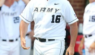 Army's head coach Joe Sottolano walks to the mound during the seventh inning against UNC Wilmington in an NCAA college baseball tournament regional game in Charlottesville, Va., Saturday, June 1, 2013. UNC Wilmington defeated Army 9-5. (AP Photo/Andrew Shurtleff)