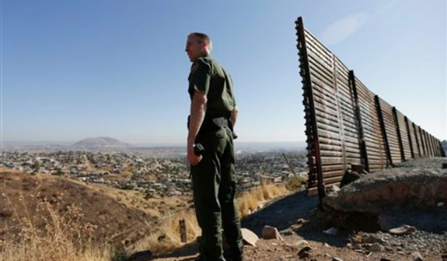 FILE    U.S. Border Patrol agent Jerry Conlin looks out over Tijuana f1c8b1d851aa