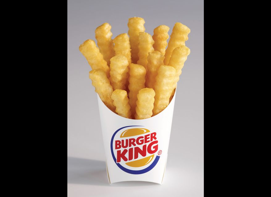 """Burger King says its new french fries, dubbed """"Satisfries,"""" have 20 percent fewer calories than its regular fries. Satisfries will cost about 30 cents more than regular fries. (AP Photo/Burger King, Noel Barnhurst)"""